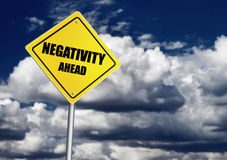 Negativity ahead sign. Over dark sly Royalty Free Stock Images