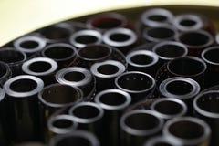 Negativos do arquivo do filme em uma lata redonda do metal fotografia de stock royalty free