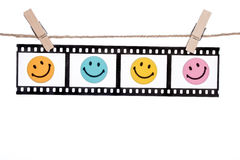 Negazioni fotografiche d'attaccatura con il fronte sorridente, commedia l felice Fotografia Stock