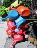 Negen gekleurde plastic gieters Royalty-vrije Stock Afbeeldingen