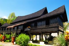 Negeri Sembilan Traditional House. The Minangkabau people migrated across the Straits of Malacca from Sumatra centuries ago and their traditional houses consist Royalty Free Stock Photos