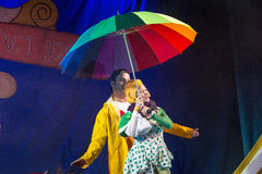Negev, Beer-Sheva, Israel - Actress and children's theater actor in Hebrew on stage with a big bright umbrella in polka dot. October 2015, youth Palace in Beer Royalty Free Stock Photos