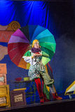 Negev, Beer-Sheva, Israel - Actress Jewish children's theater with a big bright umbrella on stage Royalty Free Stock Images