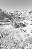 Negev Desert in Israel. Rocky hills of the Negev Desert in Israel. Wind carved rock formations in the Southern Israel Desert. Black and white picture Royalty Free Stock Photo