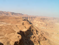 Negev desert view from Masada. Barren and rocky. Roman fortification ruins at the left Royalty Free Stock Images