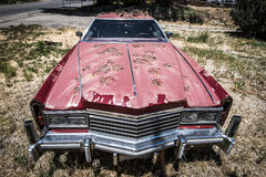 Neglected Car. An old American Car sits on the roadside in the baking sun in Colorado Royalty Free Stock Images