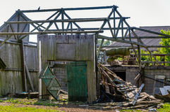 Neglected and collapsed shed from close Stock Images