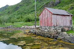 Neglected fisherman's house at the fjord coast, Lofotens, Norway Stock Photography