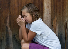 Neglected girl child cry in front of door alone Stock Images