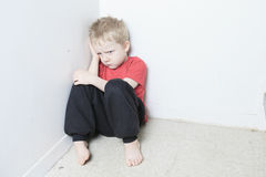 Neglected lonely child leaning at the wall. A Neglected lonely child leaning at the wall Royalty Free Stock Photography