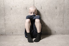 Neglected lonely child leaning at the wall. A Neglected lonely child leaning at the wall Royalty Free Stock Photo