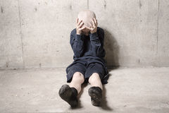 Neglected lonely child leaning at the wall. A Neglected lonely child leaning at the wall Royalty Free Stock Image