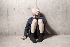 Neglected lonely child leaning at the wall. A Neglected lonely child leaning at the wall Royalty Free Stock Photos