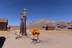 Neglected Shell gasoline station. BODIE, CA, USA - MAR 13, 2015: Abandoned vintage gas station with shooted Shell logo in Bodie ghost town royalty free stock photo