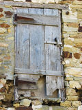 Neglected wooden door Stock Photography