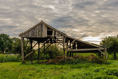 Neglected wooden shed for storage of hay and straw Stock Image