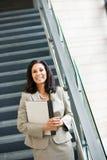 Negocio: Empresaria hispánica Stands Near Stairs Imágenes de archivo libres de regalías