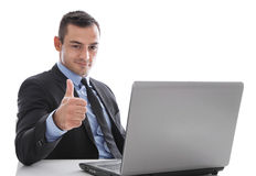 Negocio: hombre acertado que da los pulgares para arriba que asisten en el escritorio para Imagenes de archivo