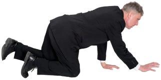 Negocio, hombre de negocios Crawl en la tierra aislada Imagen de archivo libre de regalías