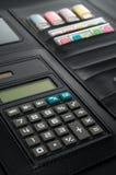 Negocio Padfolio con la calculadora Imagen de archivo libre de regalías