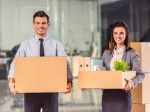 Negocio que se mueve en oficina Imagen de archivo libre de regalías