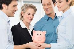 Negocio Team Saving Money Imagen de archivo libre de regalías