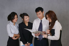 Negotiate. 4 to discuss the file of people Stock Photos