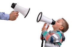 Negotiating. Father and son or teacher and pupil shouting at each other through megaphone Royalty Free Stock Photo