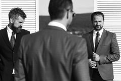 Negotiation and business concept. Leaders have business meeting. Businessmen wear smart suits. On wooden wall and nature background. Men with beard and serious Royalty Free Stock Image
