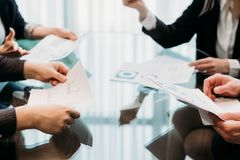 Negotiation business partnership talks cooperation. Negotiation. business partnership talks. men and women discussing cooperation conditions. professional royalty free stock photo