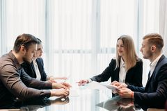 Negotiation business partnership talks cooperation. Negotiation. business partnership talks. men and women discussing cooperation conditions. professional Royalty Free Stock Photography