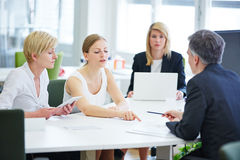 Negotiation in business team meeting Stock Image