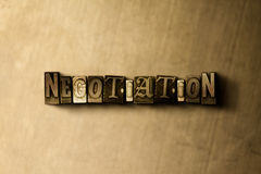 NEGOTIATION - close-up of grungy vintage typeset word on metal backdrop. Royalty free stock illustration.  Can be used for online banner ads and direct mail Stock Photos