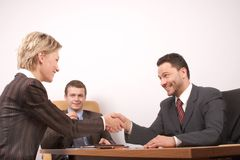 Negotiation over,man and woman  handshake - joy Royalty Free Stock Photo