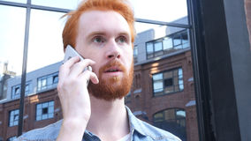Negotiation on Phone by Young Man, Outdoor Royalty Free Stock Photos
