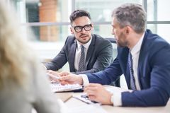 Negotiations of Bearded Business Partners Royalty Free Stock Photography
