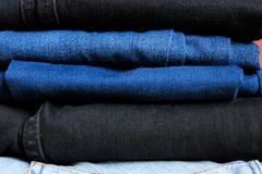 Negro azul coloreado de los vaqueros imágenes de archivo libres de regalías