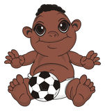 Negro baby boy with a ball. Happy baby boy with black skin sit with soccer ball Royalty Free Stock Photo
