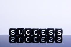 Negro del éxito en blanco Fotografía de archivo libre de regalías