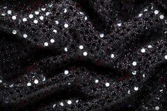 Negro del Año Nuevo de la Navidad y fondo del brillo de la plata Tela de la textura del extracto del día de fiesta Foto de archivo libre de regalías
