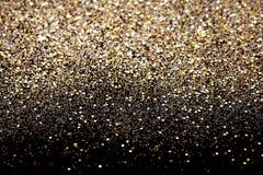 Negro del Año Nuevo de la Navidad y fondo del brillo del oro Tela de la textura del extracto del día de fiesta Fotografía de archivo libre de regalías