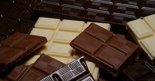 Negro, leche y barras de chocolate blancas, metrajes