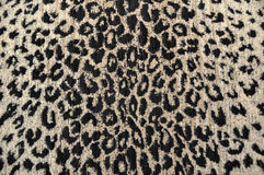 Negro y crema de la tela del leopardo Imagenes de archivo