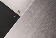 Negro y metales cepillados plata Foto de archivo libre de regalías