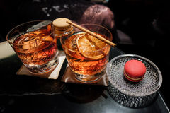Negroni cocktail with campari macaroon Stock Photography
