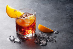 Negroni cocktail. On dark stone table. With space for your text stock image