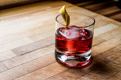 Negroni Cocktail with lemon peel and ice Royalty Free Stock Image