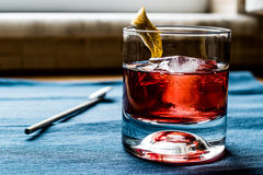 Negroni Cocktail with lemon peel and ice Royalty Free Stock Images
