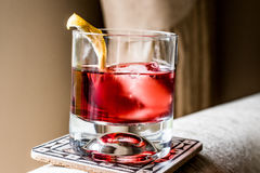 Negroni Cocktail with lemon peel and ice Stock Image