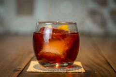 Negroni Drink ZK. The Negroni cocktail is made of one part gin, one part vermouth rosso red, semi-sweet, and one part Campari, garnished with orange peel. It is Stock Image